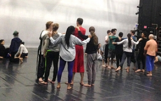 Doug Varone and Purchase College students rehearse in the shelter of the fold