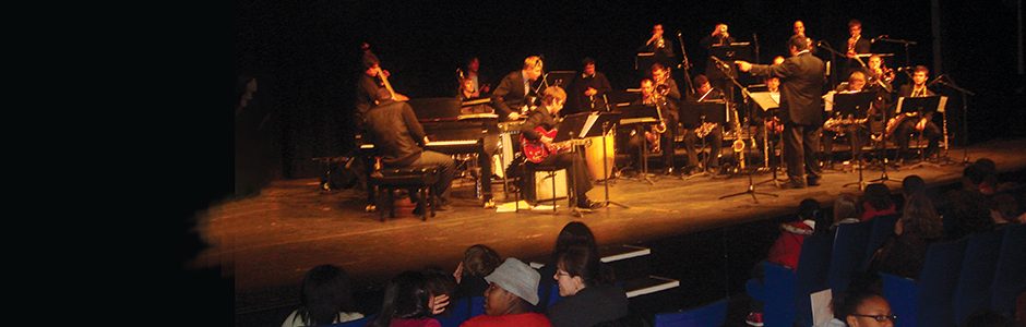 Orchestra on stage and students in the audience