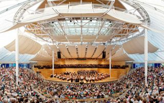 Aspen Music Festival tent with crowd and orchestra